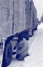 Photo of person putting chains on a vehicle